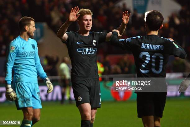 Manchester City's Belgian midfielder Kevin De Bruyne celebrates with Manchester City's Portuguese midfielder Bernardo Silva after scoring their late...