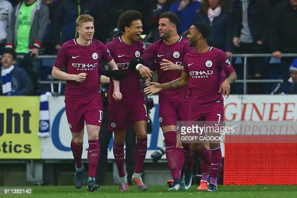 Manchester City's Belgian midfielder Kevin De Bruyne celebrates with teammates after scoring the opening goal of the English FA Cup fourth round...