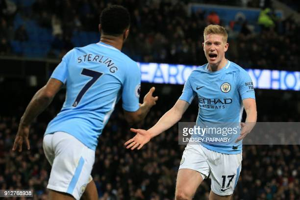 Manchester City's Belgian midfielder Kevin De Bruyne celebrates with Manchester City's English midfielder Raheem Sterling after scoring their second...