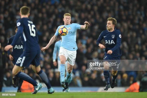 Manchester City's Belgian midfielder Kevin De Bruyne controls the ball by Tottenham Hotspur's Danish midfielder Christian Eriksen during the English...