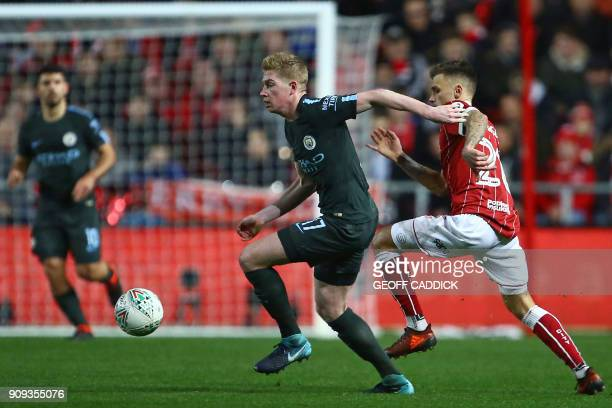 Manchester City's Belgian midfielder Kevin De Bruyne controls the ball during the English League Cup semifinal second leg football match between...