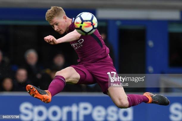 Manchester City's Belgian midfielder Kevin De Bruyne crosses the ball in the build up to their second goal during the English Premier League football...