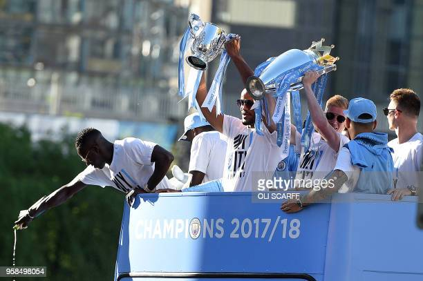Manchester City's Belgian midfielder Kevin De Bruyne holds up the Preimer Leagu trophy as Manchester City's Belgian defender Vincent Kompany holds up...