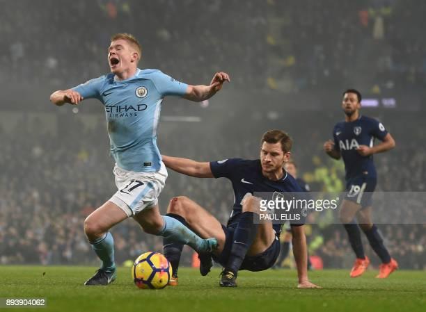 Manchester City's Belgian midfielder Kevin De Bruyne is brought down by Tottenham Hotspur's Belgian defender Jan Vertonghen for a penalty during the...