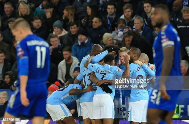 Manchester City's Belgian midfielder Kevin De Bruyne is mobbed by teammates after scoring his team's second goal during the English Premier League...