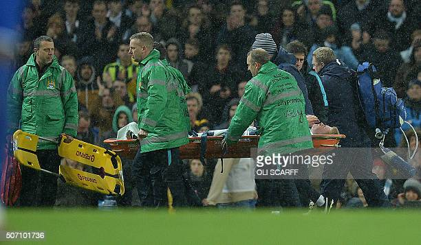 Manchester City's Belgian midfielder Kevin De Bruyne is stretchered off the pitch during the English League Cup semifinal second leg football match...