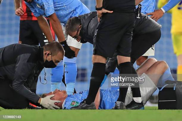 Manchester City's Belgian midfielder Kevin De Bruyne is treated by medical staff after picking up an injury during the English League Cup third round...