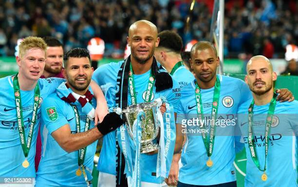 TOPSHOT Manchester City's Belgian midfielder Kevin De Bruyne Manchester City's Argentinian striker Sergio Aguero Manchester City's Belgian defender...