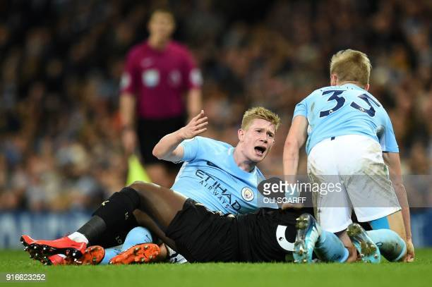 Manchester City's Belgian midfielder Kevin De Bruyne reacts after being penalised for a foul on Leicester City's Malian midfielder Fousseni Diabate...