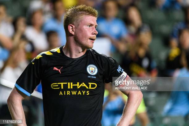Manchester City's Belgian midfielder Kevin De Bruyne reacts before taking a corner kick during the friendly football match between English Premier...