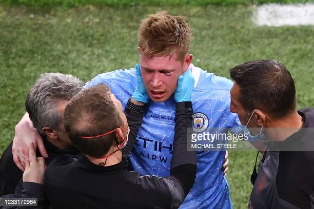 Manchester City's Belgian midfielder Kevin De Bruyne receives treatment on the sidelines during the UEFA Champions League final football match...