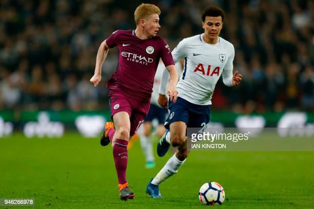 Manchester City's Belgian midfielder Kevin De Bruyne runs away from Tottenham Hotspur's English midfielder Dele Alli during the English Premier...