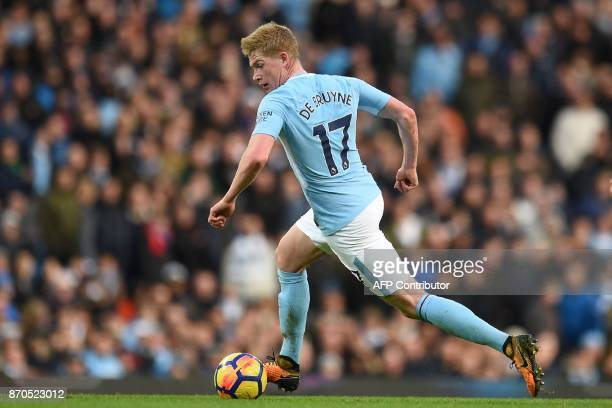 Manchester City's Belgian midfielder Kevin De Bruyne runs with the ball during the English Premier League football match between Manchester City and...
