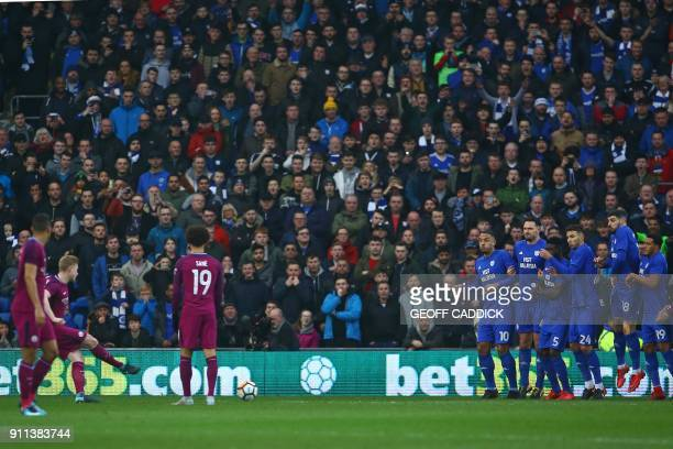 Manchester City's Belgian midfielder Kevin De Bruyne scores the opening goal by passing the ball under the Cardiff wall during the English FA Cup...