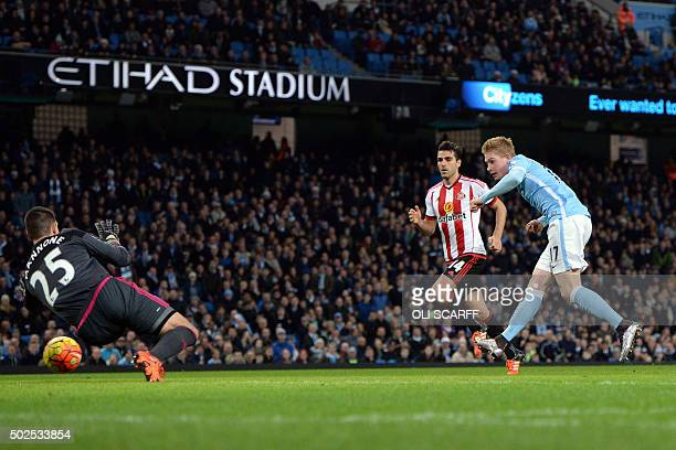 Manchester City's Belgian midfielder Kevin De Bruyne scores their fourth goal past Sunderland's Italian goalkeeper Vito Mannone as Sunderland's...