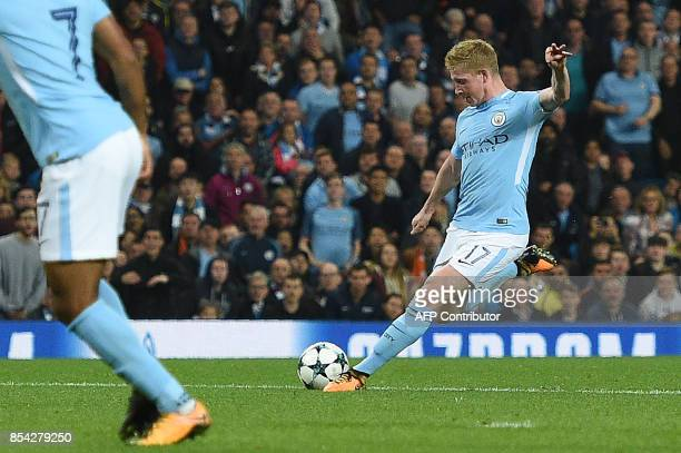 Manchester City's Belgian midfielder Kevin De Bruyne shoots but fails to score during the Group F football match between Manchester City and Shakhtar...