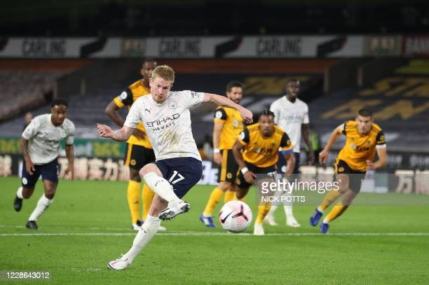 Manchester City's Belgian midfielder Kevin De Bruyne shoots from the penalty spot to score his team's opening goal during the English Premier League...