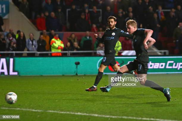 Manchester City's Belgian midfielder Kevin De Bruyne shoots to score their late winning goal during the English League Cup semifinal second leg...