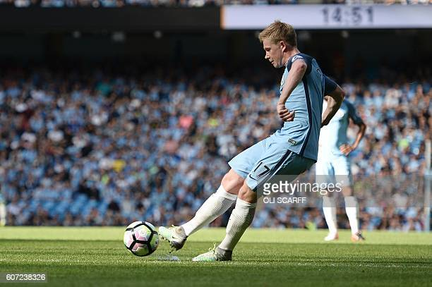 Manchester City's Belgian midfielder Kevin De Bruyne takes a free kick to score the opening goal during the English Premier League football match...