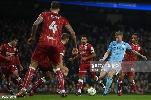 Manchester City's Belgian midfielder Kevin De Bruyne takes on the Bristol CIty defence during the English League Cup semifinal first leg football...