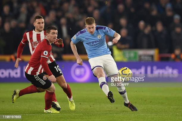 Manchester City's Belgian midfielder Kevin De Bruyne tries a shot at goal during the English Premier League football match between Sheffield United...