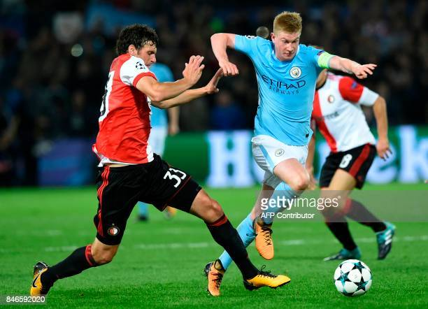 Manchester City's Belgian midfielder Kevin De Bruyne vies for the ball with Feyenoord's Dutch defender Eric Botteghin during the UEFA Champions...