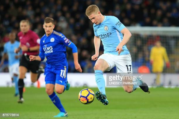 Manchester City's Belgian midfielder Kevin De Bruyne vies with Leicester City's English midfielder Marc Albrighton during the English Premier League...