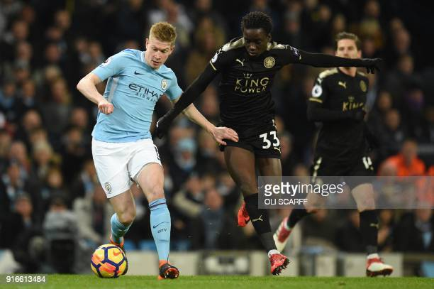 Manchester City's Belgian midfielder Kevin De Bruyne vies with Leicester City's Malian midfielder Fousseni Diabate during the English Premier League...