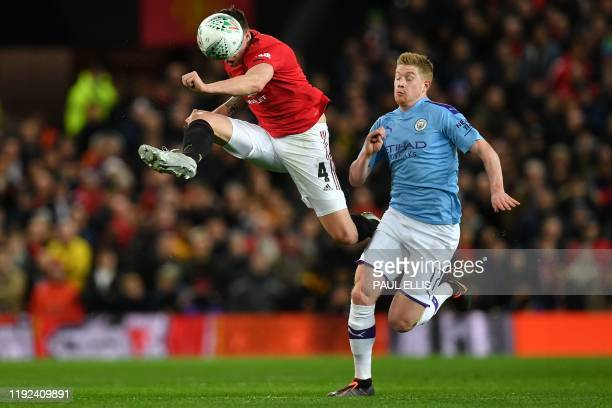 Manchester City's Belgian midfielder Kevin De Bruyne vies with Manchester United's English defender Phil Jones during the English League Cup...