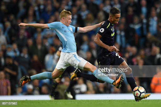 Manchester City's Belgian midfielder Kevin De Bruyne vies with Everton's English defender Mason Holgate during the English Premier League football...