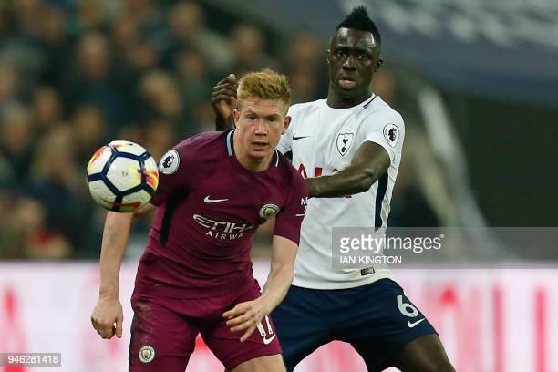 Manchester City's Belgian midfielder Kevin De Bruyne vies with Tottenham Hotspur's Colombian defender Davinson Sanchez during the English Premier...