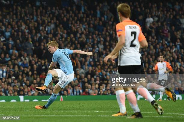 Manchester City's Belgian midfielder Kevin De Bruyne watches his shot after scoring his team's first goal during the Group F football match between...