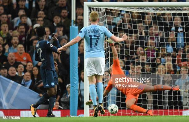 Manchester City's Belgian midfielder Kevin De Bruyne watches his shot hit the crossbar and fail to score during the UEFA Champions League Group F...