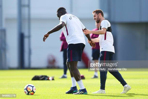 Manchester City's Benjamin Mendy and Bernardo Silva during the training session at Manchester City Football Academy on April 18 2018 in Manchester...