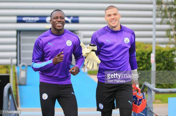 Manchester City's Benjamin Mendy and Ederson in action during training at Manchester City Football Academy on September 13 2019 in Manchester England
