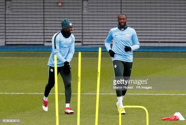 Manchester City's Benjamin Mendy and Manchester City's Yaya Toure during the training session at the CFA Manchester
