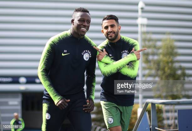 Manchester City's Benjamin Mendy and Riyad Mahrez during training at Manchester City Football Academy on August 30 2018 in Manchester England