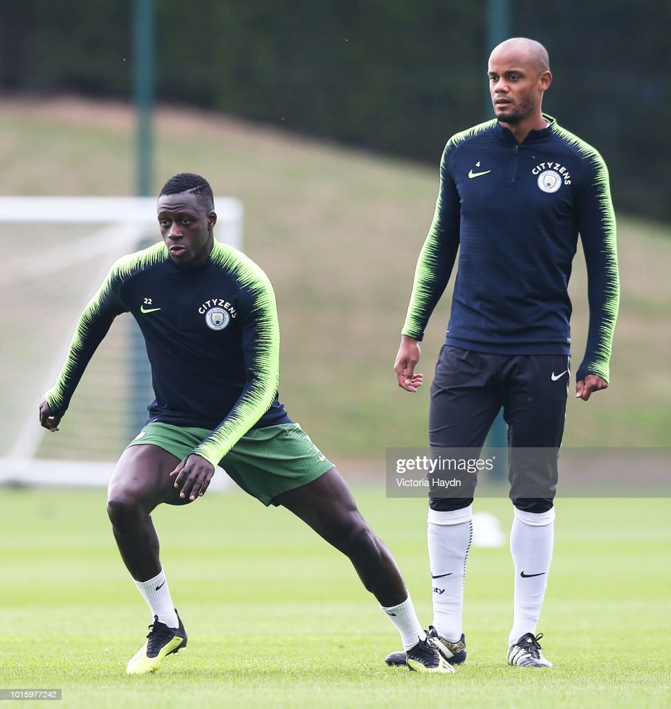 Manchester City's Benjamin Mendy and Vincent Kompany during training at Manchester City Football Academy on August 10, 2018 in Manchester, England.