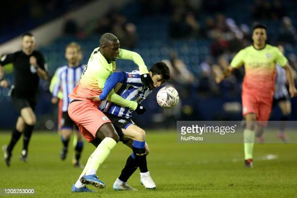Manchester City's Benjamin Mendy battles with Sheffield Wednesday's Fernando Forestieri during the FA Cup Fifth Road match between Sheffield...