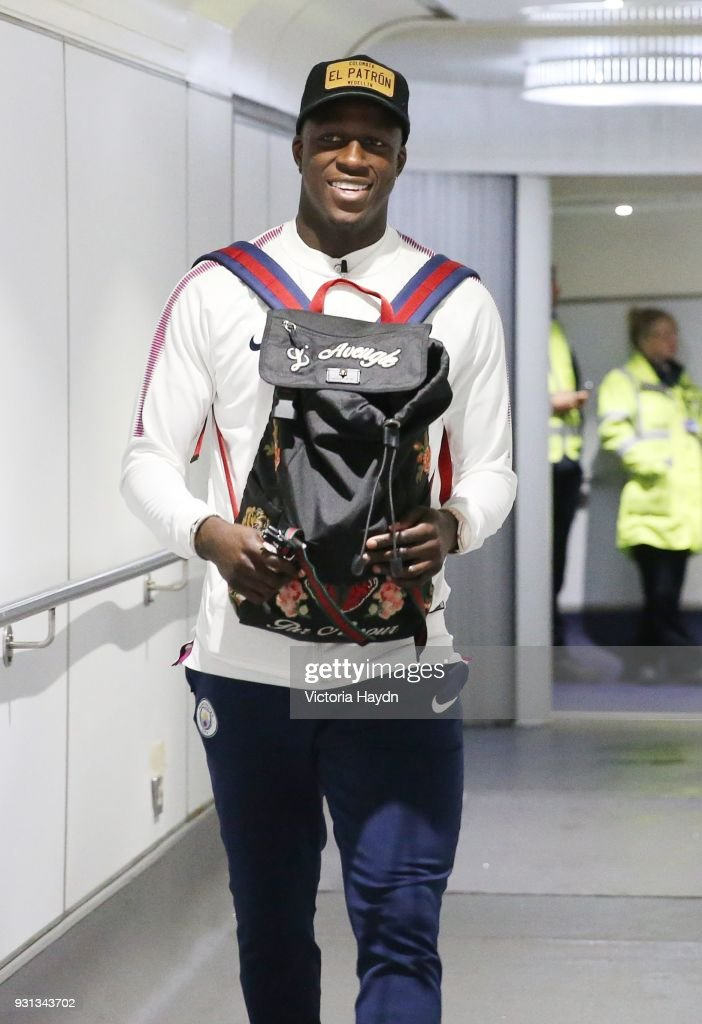 Manchester City's Benjamin Mendy boards the flight at Manchester Airport on March 13, 2018 in Manchester, England.