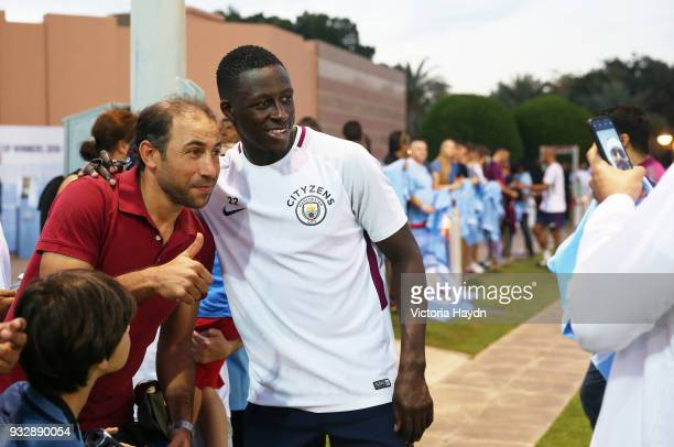 Manchester City's Benjamin Mendy interacts with fans during the training session on March 16 2018 in Abu Dhabi United Arab Emirates
