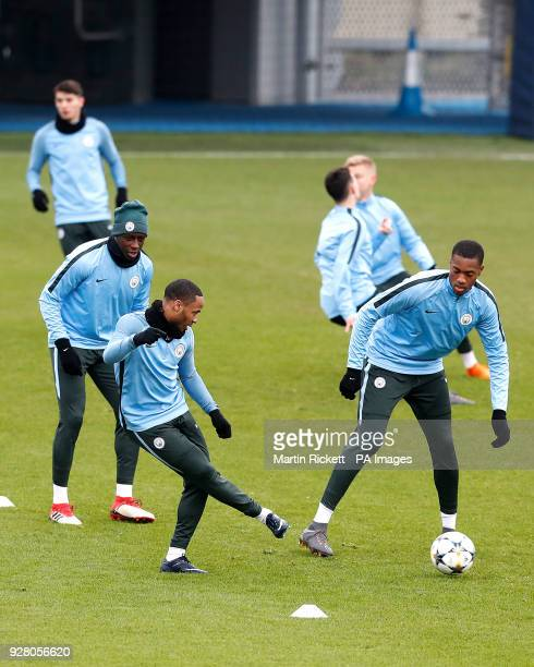 Manchester City's Benjamin Mendy Manchester City's Raheem Sterling and Manchester City's Tosin Adarabioyo during the training session at the CFA...