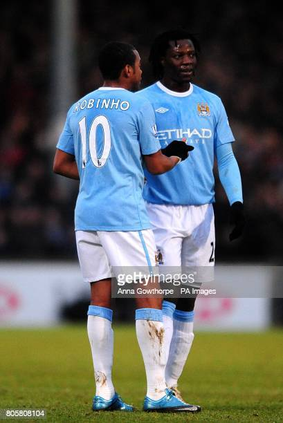 Manchester City's Benjani Mwaruwari speaks with team mate De Souza Robinho