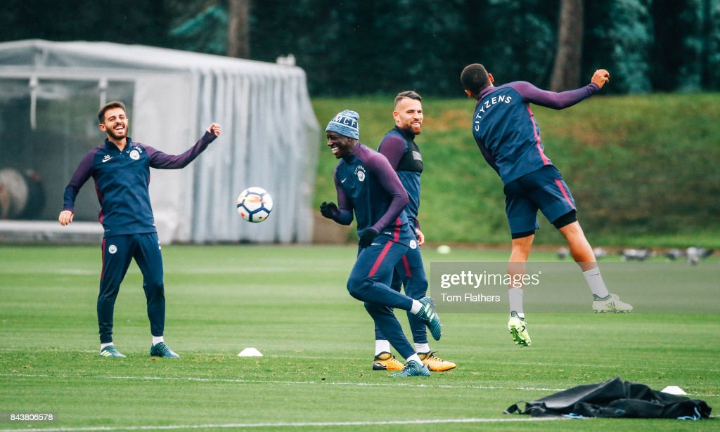 Manchester City's Bernardo Silva and Benjamin Mendy during training at Manchester City Football Academy on September 7, 2017 in Manchester, England.