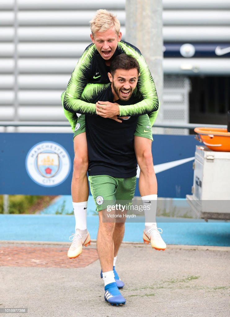 Manchester City's Bernardo Silva and Oleksandr Zinchenko during training at Manchester City Football Academy on August 10, 2018 in Manchester, England.