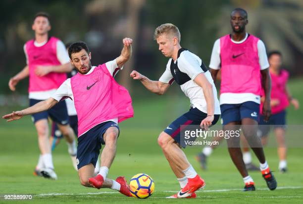 Manchester City's Bernardo Silva and Oleksandr Zinchenko during the training session on March 16 2018 in Abu Dhabi United Arab Emirates