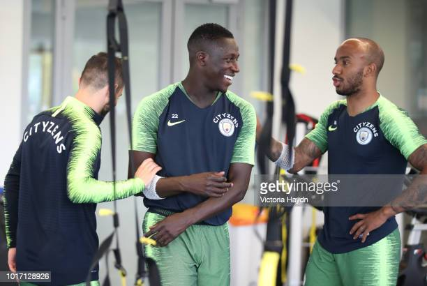 Manchester City's Bernardo Silva Benjamin Mendy and Fabian Delph during training in the gym at Manchester City Football Academy on August 15 2018 in...
