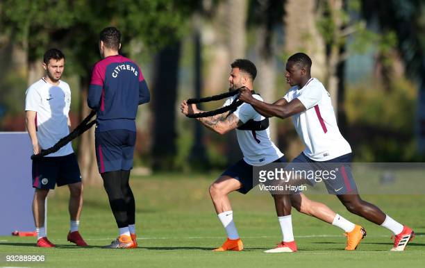Manchester City's Bernardo Silva Ederson Moraes Kyle Walker and Benjamin Mendy during the training session on March 16 2018 in Abu Dhabi United Arab...