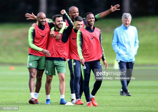 Manchester City's Bernardo Silva Fabian Delph Raheem Sterling Phil Foden and Vincent Kompany celebrate during training at Manchester City Football...