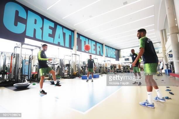 Manchester City's Bernardo Silva Gabriel Jesus Fernandinho and Riyad Mahrez during training in the gym at Manchester City Football Academy on August...